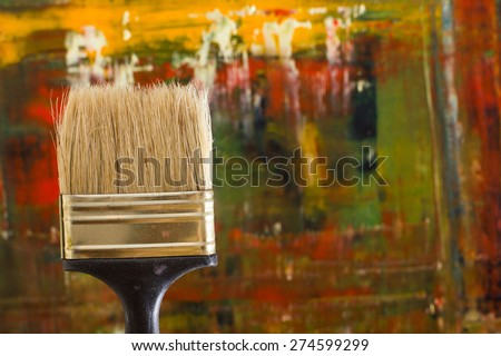 Abstract pained canvas. Oil paints on a palette and brush. Colorful background. Copy space. - stock photo