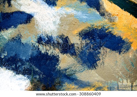 Abstract paint brush on colorful wall background with kid. Acrylic hand painted with earth tone. Fashion and street. Close up. - stock photo