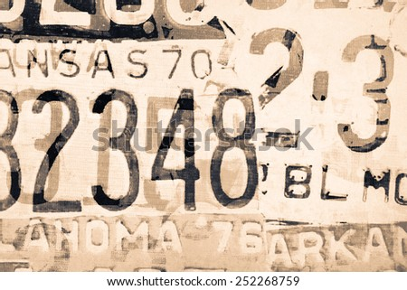 Abstract painting on canvas texture inspired by car license plate - stock photo