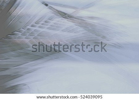 Abstract palm tree in motion against sunlight. Dynamic pattern, blurred leaves moving in wind, for vintage concept business blog, nature t-shirt design shop, ambient music. Image with filter effect