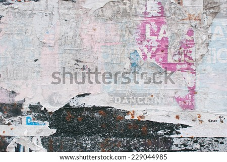 Abstract paper collage of faded anonymous billboard posters - stock photo