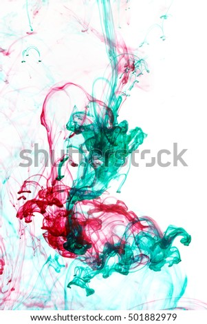 Abstract pattern falling into the water drop of red and green ink