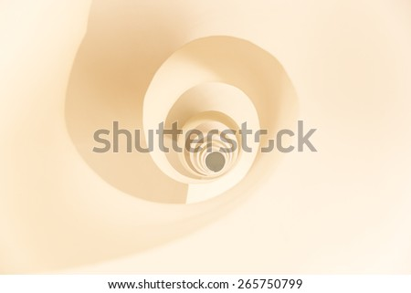 abstract pattern formed by a spiral staircase - stock photo