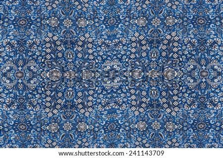 Abstract patterns based on Finely woven silk carpets  in a carpet showroom in  Cappadocia, Turkey - stock photo