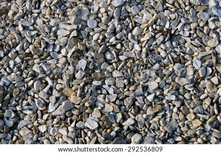 Abstract pebble or shingle background. - stock photo