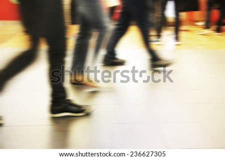 Abstract people are walking in the city. Motion blur.