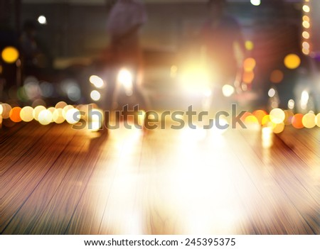 abstract people walk on wood floor at night in the city, soft and blur concept, blank text - stock photo