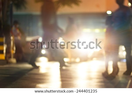 abstract people walk street at night in the city, colorful and blur concept - stock photo