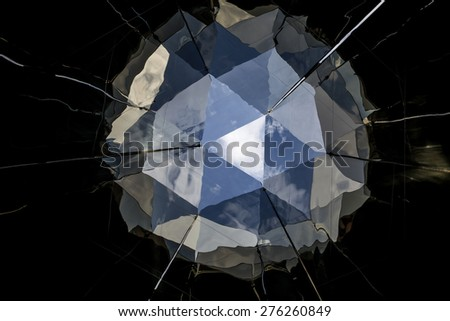 Abstract photo of a mirror reflecting the blue sky forming a ball shape useful as a background or texture. - stock photo