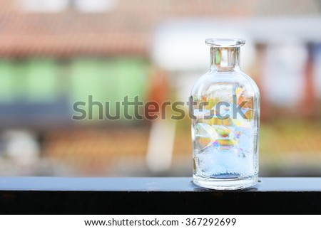 Abstract photo of bottle with soap bubbles - stock photo