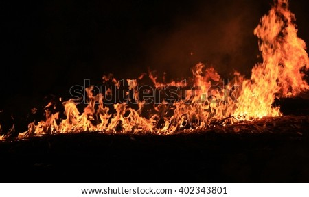 Abstract photo of fire  a black background  - stock photo