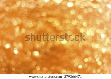 abstract photo of light burst and glitter bokeh lights. image is blurred and filtered