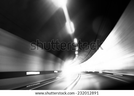 Abstract photo of motion in the tunnel - stock photo