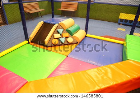 Abstract photograph featuring childrens play equipment at a fast food restaurant  - stock photo