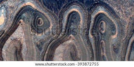 abstract photography deserts of Africa from the air, abstract surrealism, Three Graces,allegory in stone in the desert,abstract landscape,fantasy landscape eroded by water - stock photo