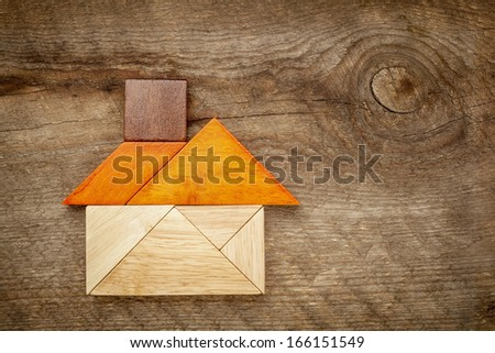 abstract picture of a house built from seven tangram wooden pieces, a traditional Chinese puzzle game, the artwork copyright by the photographer