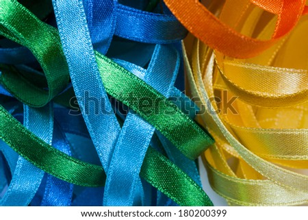 Abstract picture of colored sewing ribbons - stock photo