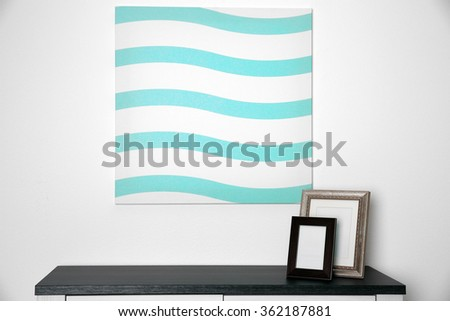 Abstract picture with frames on a white wall background - stock photo