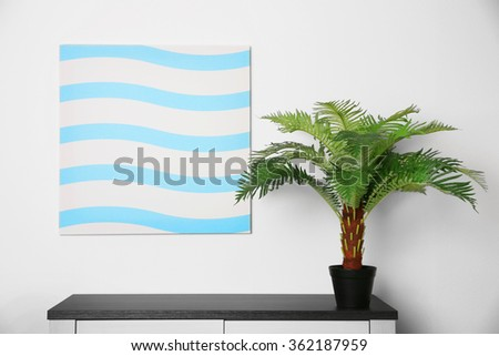 Abstract picture with green plant on a white wall background - stock photo