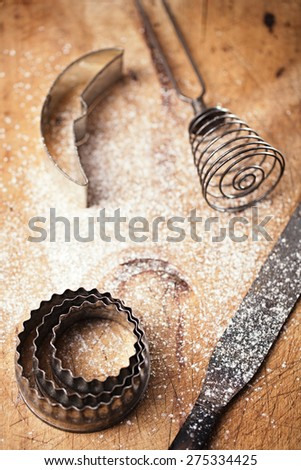 abstract picture with Vintage  Baking utensils and flour on wooden backdrop - stock photo