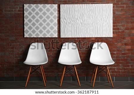 Abstract pictures with chairs on a brick wall background - stock photo