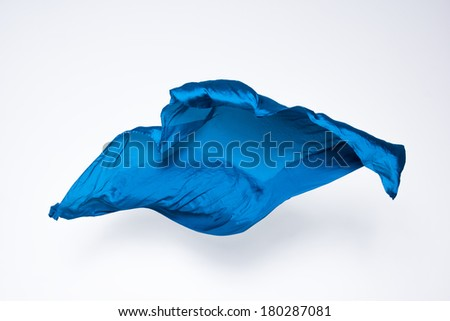 abstract pieces of blue fabric flying, high-speed studio shot - stock photo