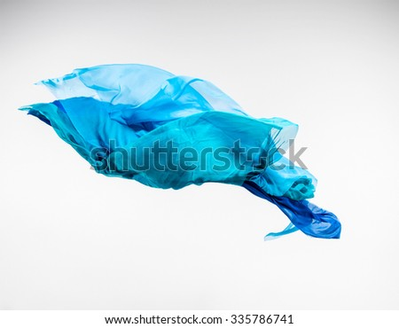 abstract pieces of fabric flying, high-speed studio shot - stock photo