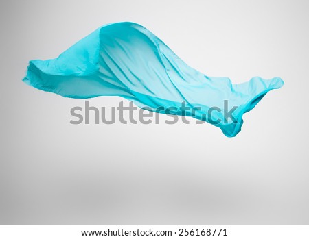 abstract pieces of green fabric flying, high-speed studio shot
