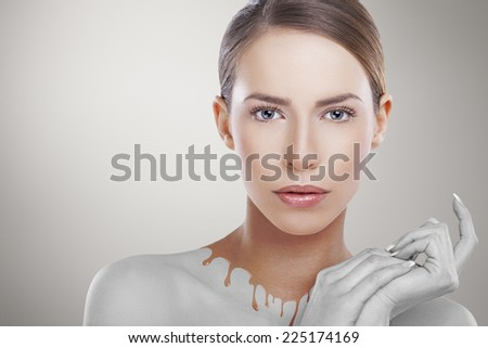 Abstract portrait of beautiful Caucasian female model. Skin care concept. Small amount of noise added. - stock photo