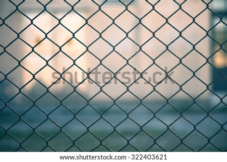Abstract prohibited area security fence background with blurred background.