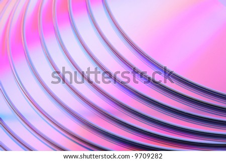 Abstract purple CD background. Closeup of stacked CDs or DVDs.