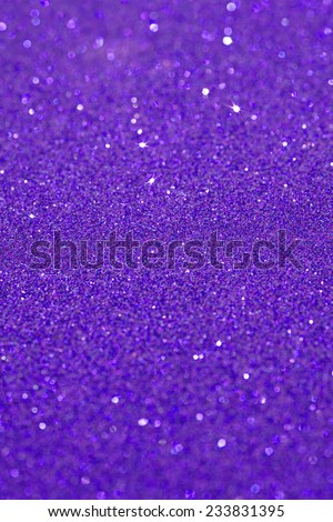 Abstract purple glitter festive background texture with shining glitter stars. Full frame blue color christmas detail with blurred areas. Artistic colorful background drop frame. - stock photo