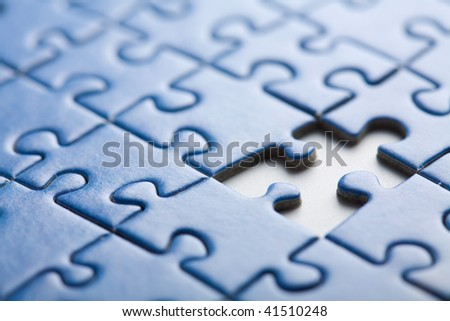 abstract puzzle background with one piece missing - stock photo
