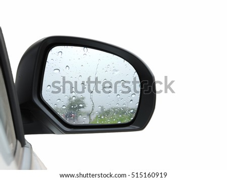 Abstract raindrops on car rear-view mirror.  isolated