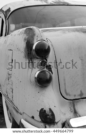 Abstract Rear Corner View of an old rusted out scrap car that has been abandoned - stock photo