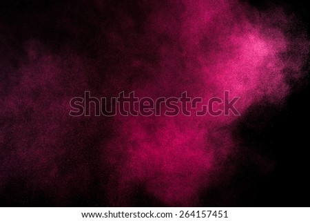 Abstract red and pink paint Holi. Abstract red and pink powder explosion on black background. - stock photo