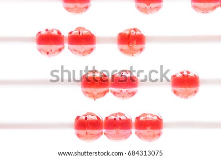 Abstract red beads on white wire