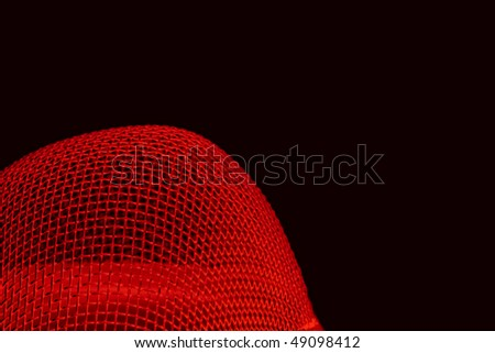 Abstract red curved spherical metal grid structure isolated on black with selective focus - stock photo