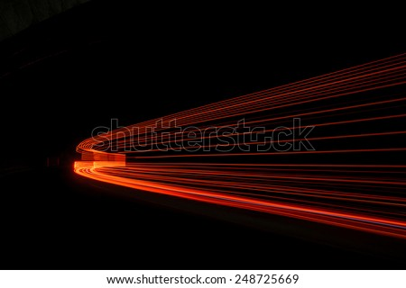 Abstract red rays of light in a car tunnel - stock photo
