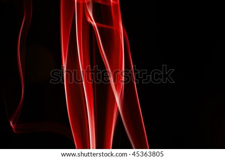 Abstract red smoke shot against black background - stock photo