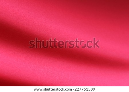 abstract red smooth fabric backgroud - stock photo
