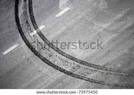 abstract road background with crossing of road marking and tires track - stock photo