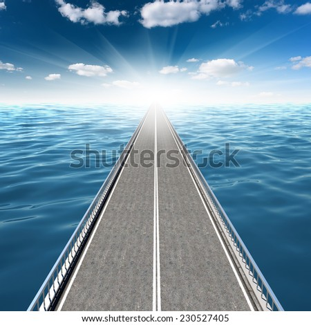 Abstract road in the sea goes far beyond the horizon - stock photo