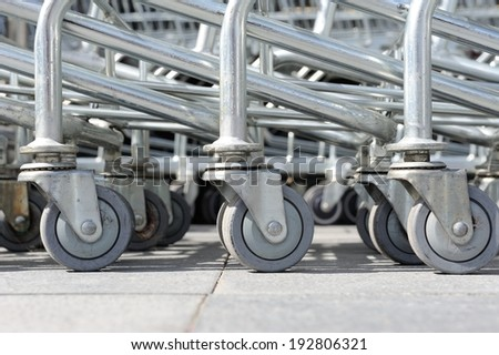 abstract roller of shopping cart at parking lot - stock photo