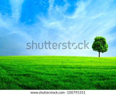 Abstract rural landscape. Green meadow under the blue skies - stock photo