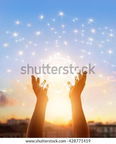 Abstract science, circle global network connection in hands on sunset background - stock photo