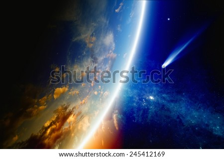 Abstract scientific background - comet approaches glowing planet Earth, nebula and stars in space. Elements of this image furnished by NASA nasa.gov - stock photo