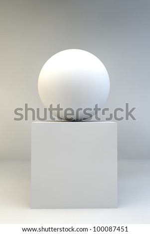 Abstract sculpture of a white sphere balanced on a white cube - stock photo