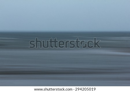 Abstract sea tones from panning camera movement - stock photo