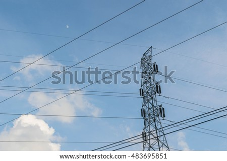 Abstract semi silhouette soft blurred and soft focus of the sunset with high voltage  pole tower with the moon, blue sky  and cloudy background in the evening in Thailand.